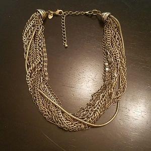 Lia Sophia Kiam Family multi layer gold necklace.